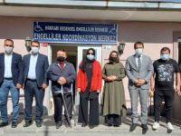 Başdanışman Orhan ve Ak Partili Gür'den Bedensel Engelliler Derneğine ziyaret